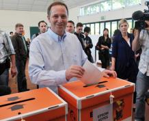 John Key votes on election day.
